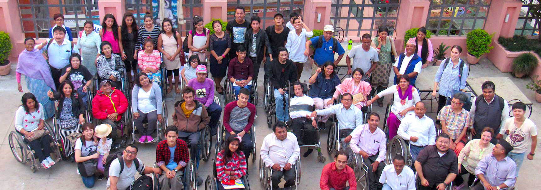 Group photo of CIL members and Staffs infront of a building.