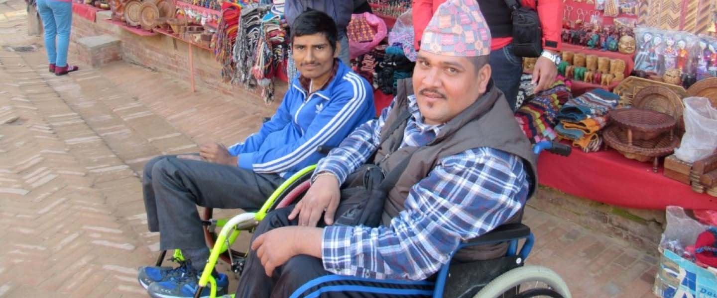 Two persons with disabilities in wheelchair