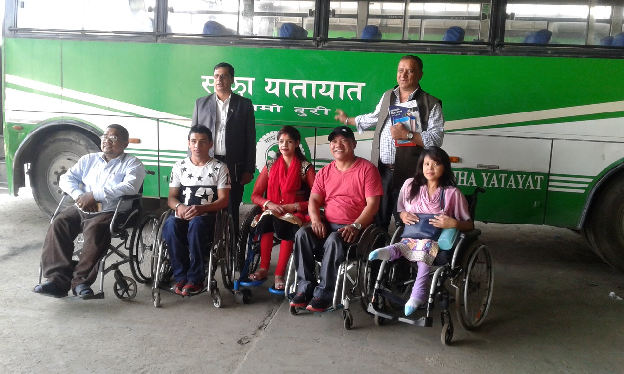 Officials from CIL-Kathmandu and Sajha yatayat poses infront of a bus after monitoring
