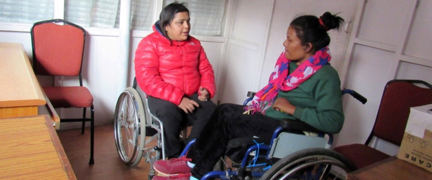 Two ladies in wheelchair