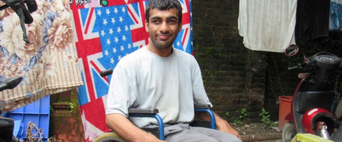 Sudip Simkhada sitting on a wheelchair