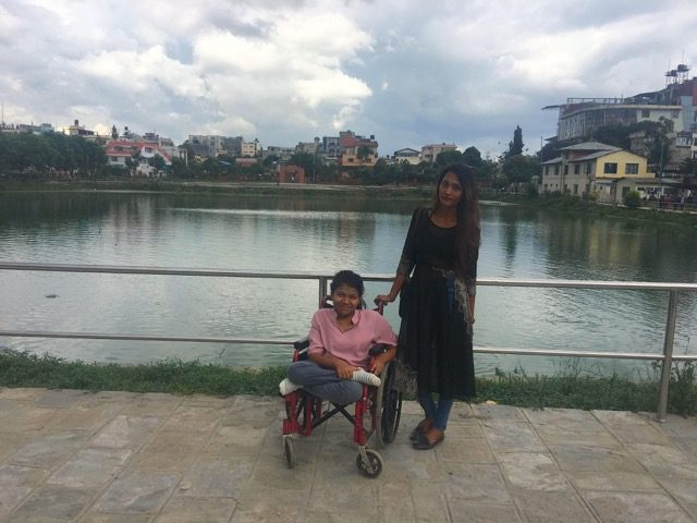 Bhumi thapa and her attendant infront of a beautiful lake.